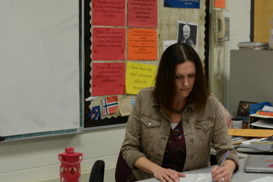 English teacher Kim Hart grades work.