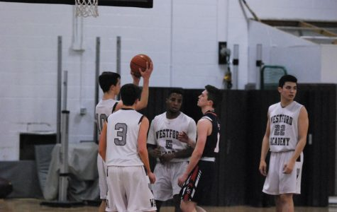 Boys' basketball dominates last game of their season