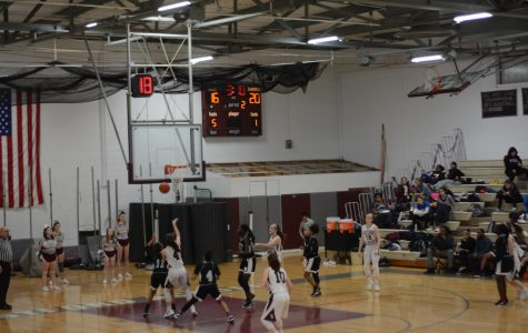 WA girls basketball wins intense game against Cambridge Ridge and Latin