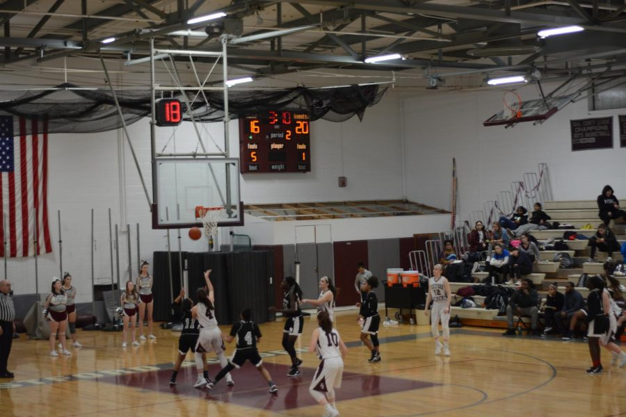 WA girls basketball wins intense game against Cambridge Ridge and Latin