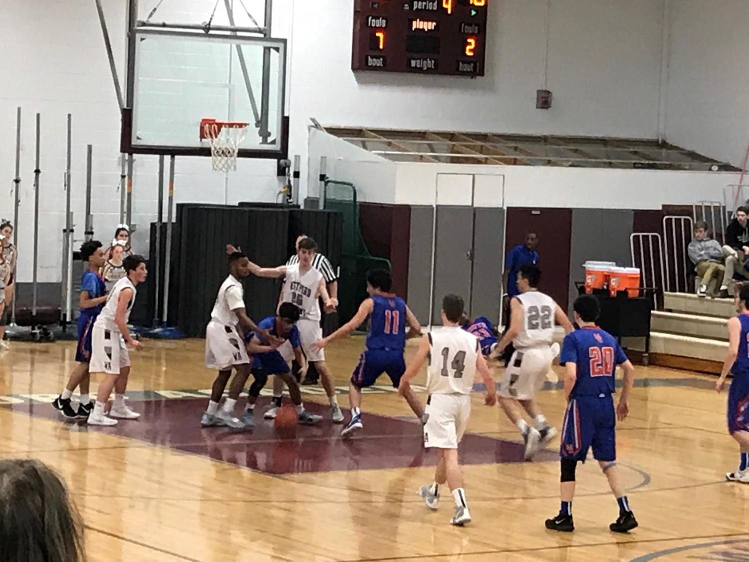 WA  Varsity Boys'  Basketball playing against Newton-South during the fourth quarter.