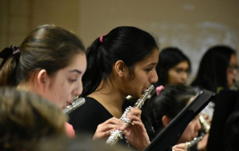 Juniors Alexa Klamka and Shreya Bose play the flute during Gabriel's Oboe.