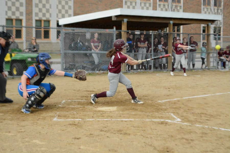 Junior Maeve Proulx hits the ball