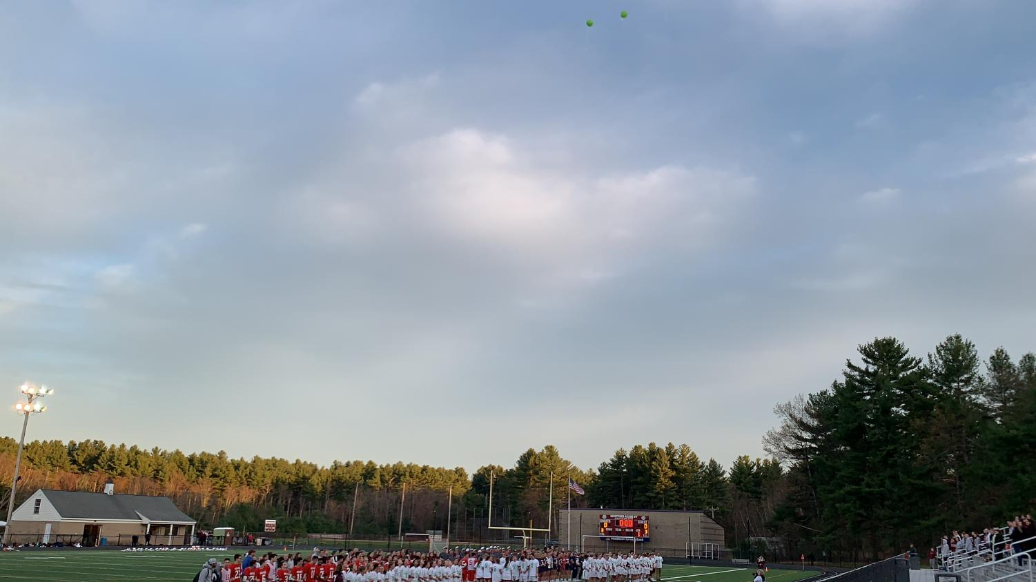 Westford+Academy+teams+release+balloons+in+support+for+Mental+Health+awareness.+Two+balloons+can+be+seen+floating+away.