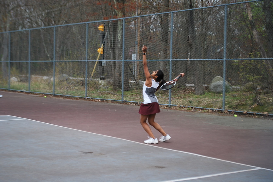 Nithya Sastry serving the ball for WA.