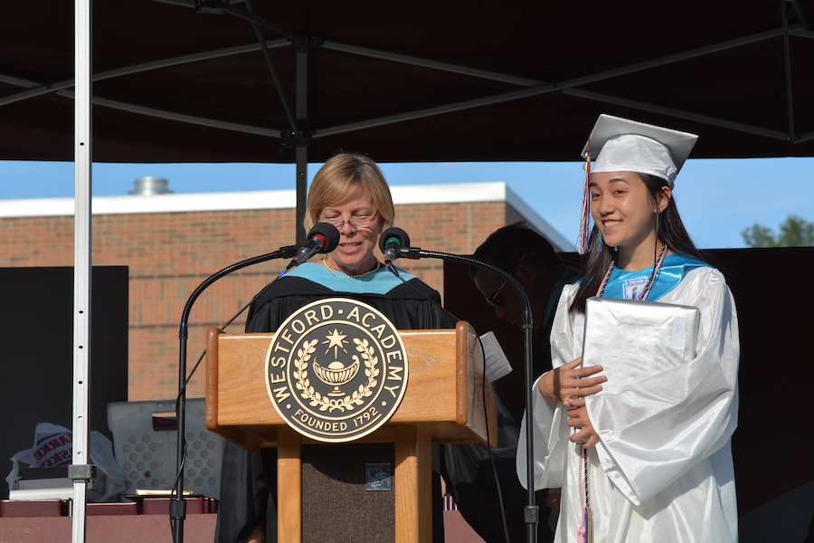Helen being honored as salutatorian at graduation