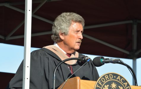 Superintendent Bill Olsen addresses the class before they accept their diplomas