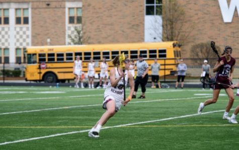 Abby Katz makes an attack for college lacrosse