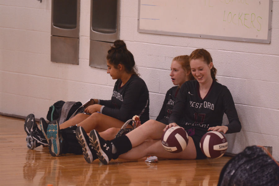 JV+players+watch+the+varsity+volleyball+game.