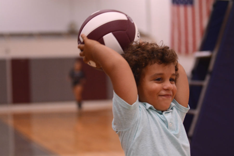 Little+boy+throws+in+a+volleyball+