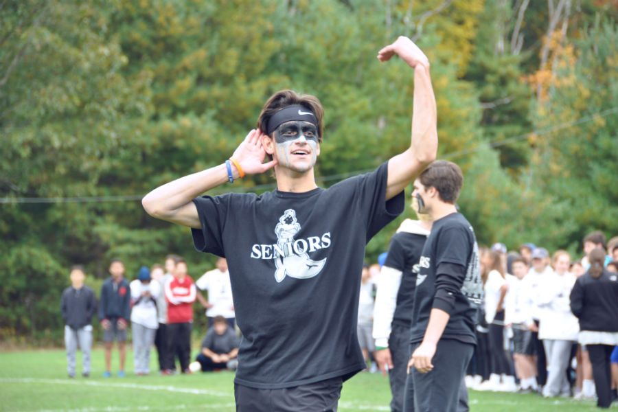 A senior receiving praise from his classmates before a dodgeball game