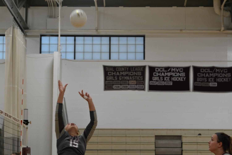 Senior Skyler Anderson sets the ball.