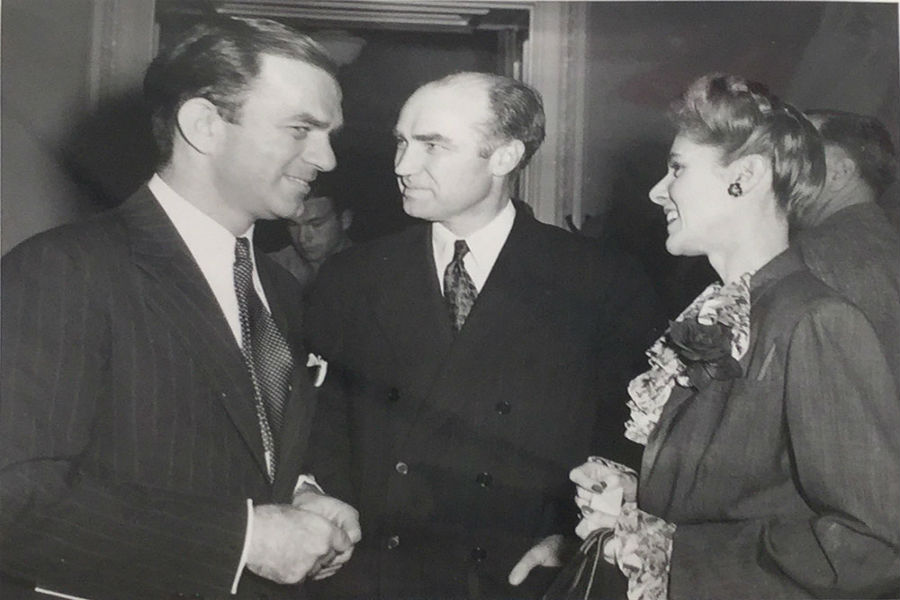 Clare Boothe Luce and Senator Fulbright, conversing at a party.