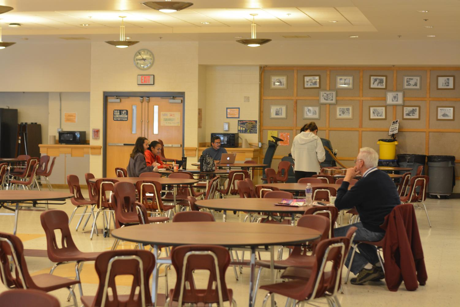 Substitute Dick Mungovan watches over a DLT in the cafeteria.