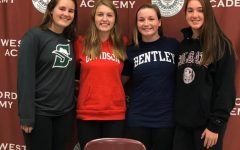 Four seniors sign to continue their athletic careers in college
