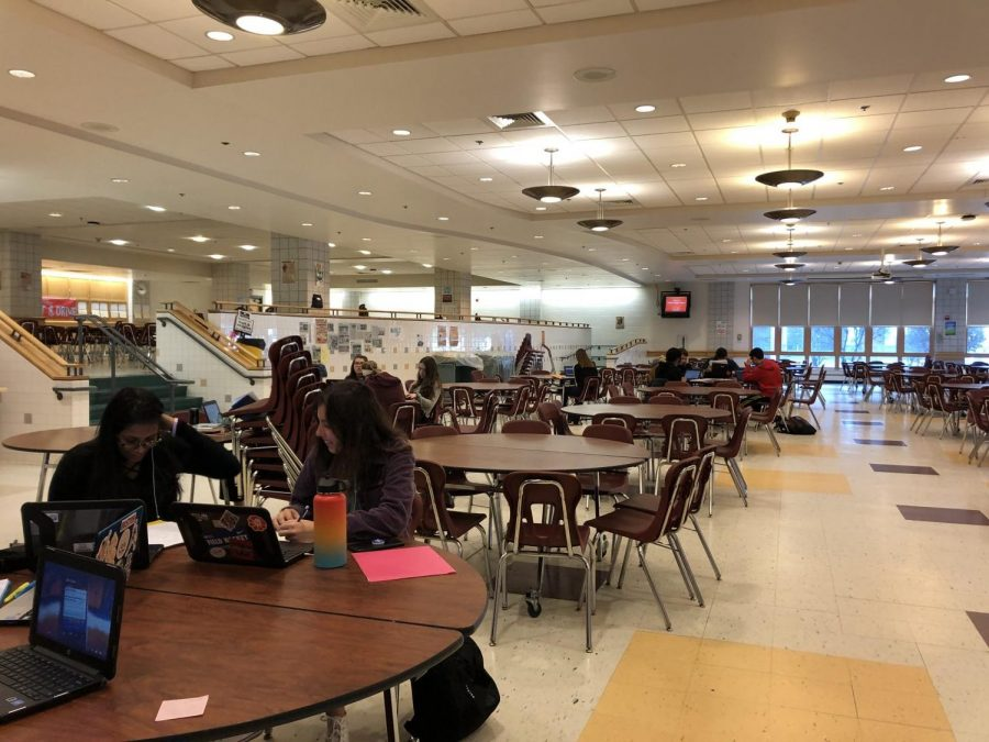 Students in the cafe completing classwork.