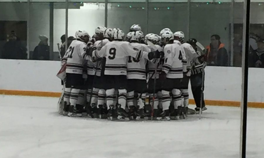 The+boys%27+hockey+team+huddles+up+before+their+game+against+Newburyport.
