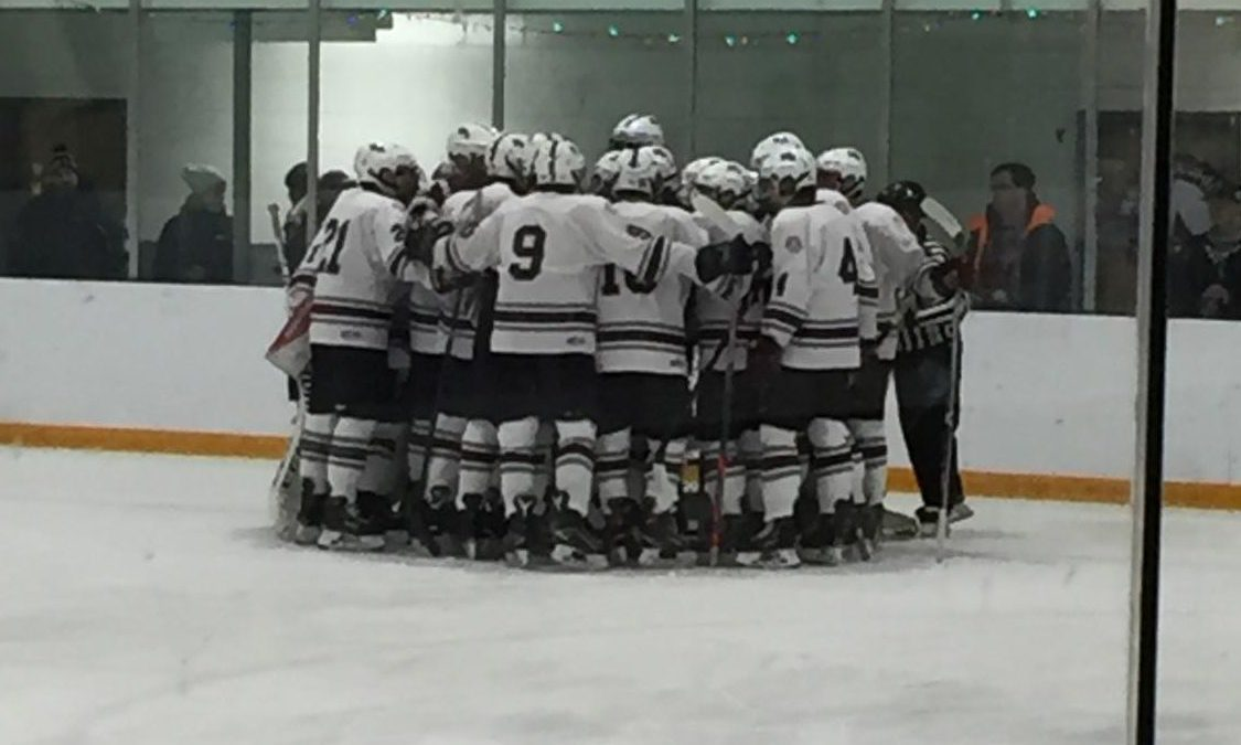 The boys' hockey team huddles up before their game against Newburyport.