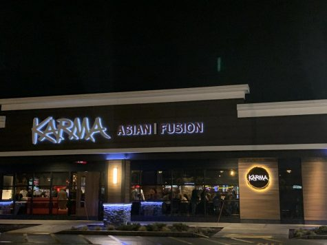 The exterior of Karma looks modern in the parking lot.