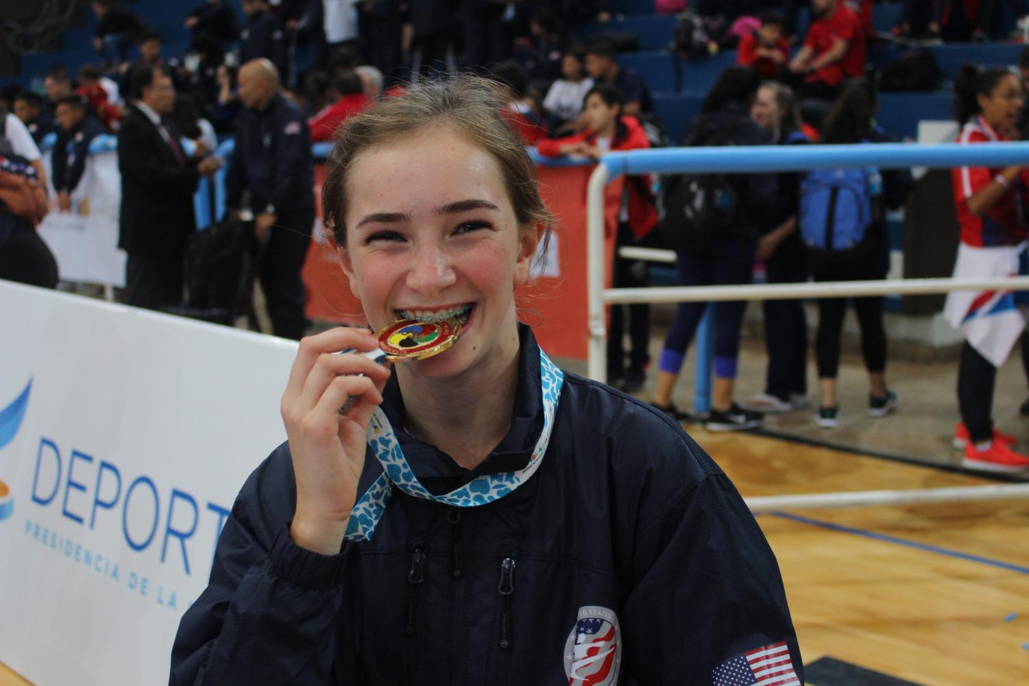 Victoria Princi bites down on her gold medal at the Pan-American tournament in Argentina.