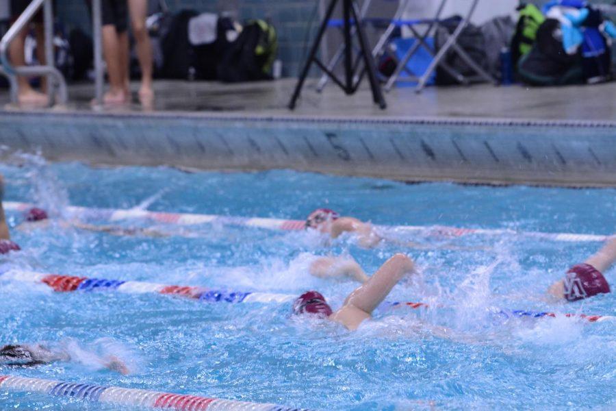 WA+swim+team+warms+up+before+the+meet.