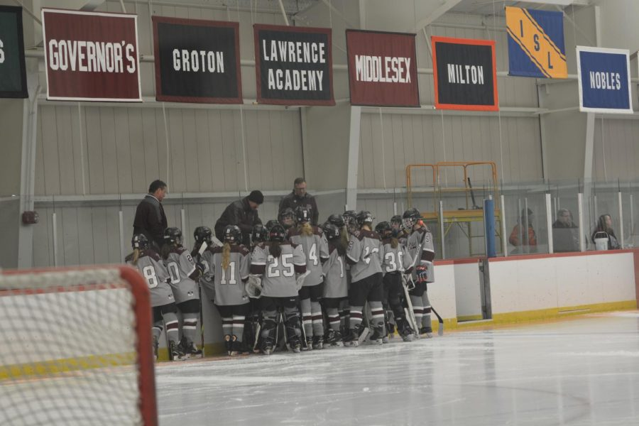 WA+girls%27+hockey+team+huddles+together+before+their+game+starts.