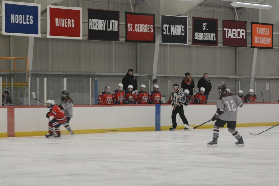 Players+from+Tewksbury-Methuen+watch+the+game+from+the+sidelines.+