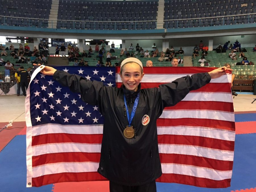 Victoria+Princi+holds+an+American+flag+at+the+Pan-American+tournament+in+Ecuador.+She+smiles+after+winning+a+bronze+medal+in+her+category.