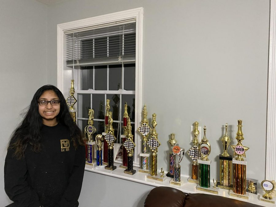 Saanvi Tiruveedhula showing her trophies.