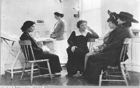 Sanger with her sister Ethel inside their clinic on Amboy Street in Brooklyn, New York