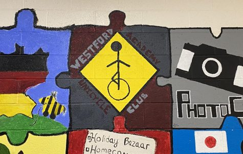 One of the puzzle pieces outside the cafeteria portraying the unicycle club, an important part of WAs' history.
