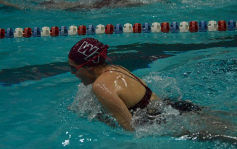 Sophomore Vivian Aeder comes up for a breath during the 100yd breaststroke.