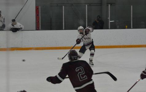 Sophomore Ryan McCarthy shoots a slapshot.