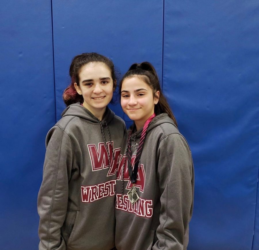 Junior Gianna Pannese (left) and freshmen Giselle Piedrahita (right) smiling for a picture after a competition.
