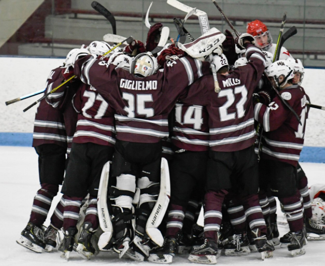 WA+Boys%27+Hockey+team+celebrates+their+win+against+Waltham.+
