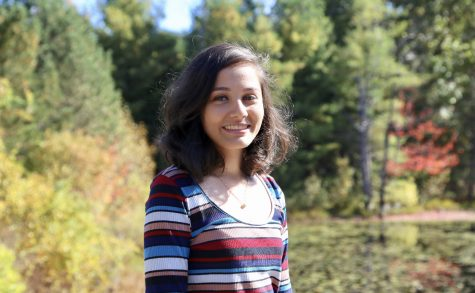 Shivangi Ranjan smiles brightly for her senior picture in the beautiful fall environment of New England, an opportunity she won