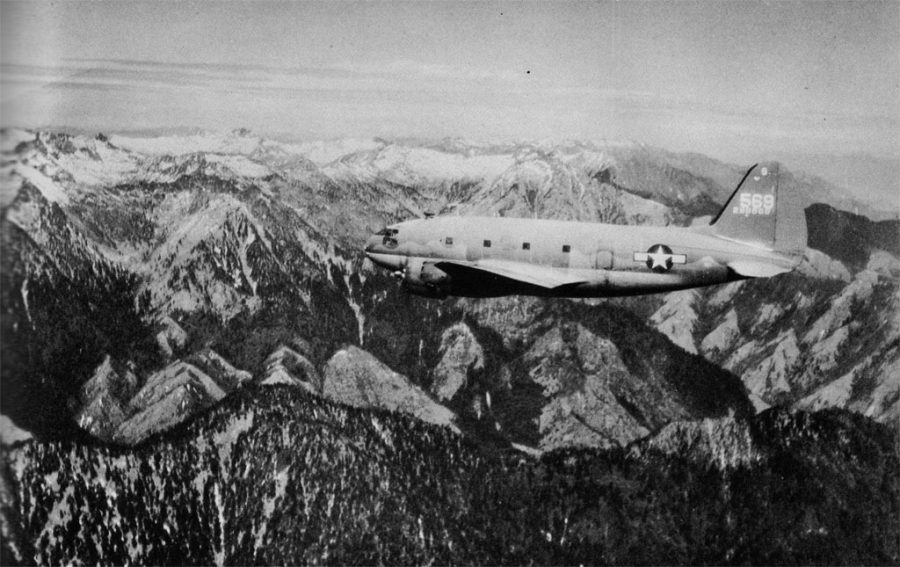 A Commando C-46 flies over
