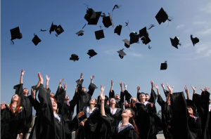 Students throw up their graduation hats, excited for the next chapter of their lives.