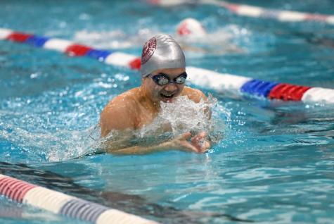 Bryce Fan swims breaststroke.
