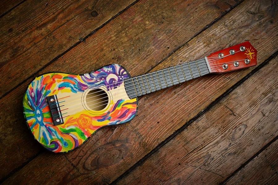 A ukulele sits, waiting to be used.
