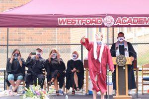 Class president Wasylyshyn throws graduation cap in the air