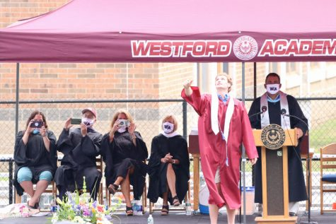 Class president Wasylyshyn throws graduation cap in the air