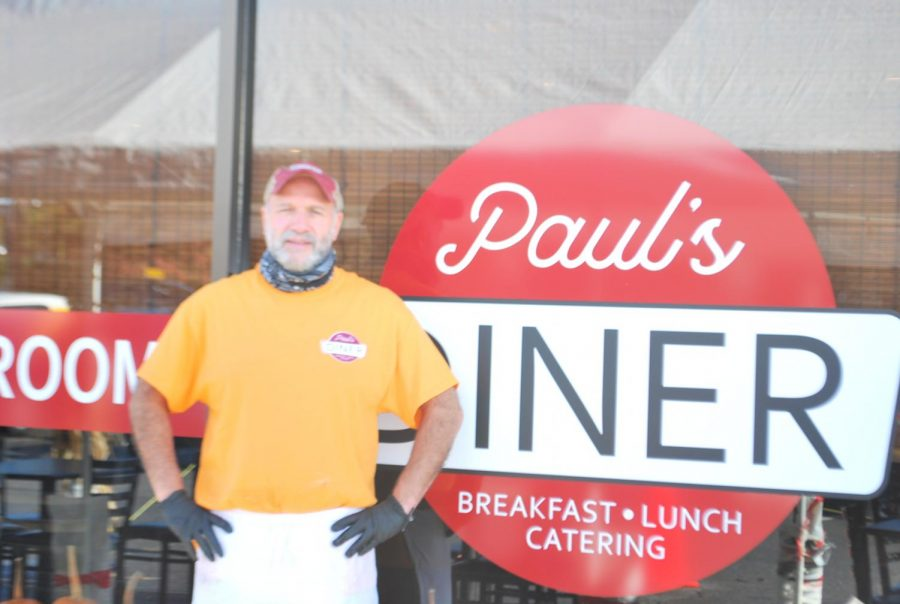 Owner of Paul's Diner, Sal Buonacore, stands in front of Paul's Diner sign.