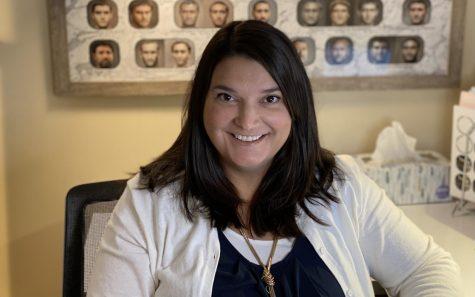 New Latin teacher, Kori Pasternak smiles for the camera.