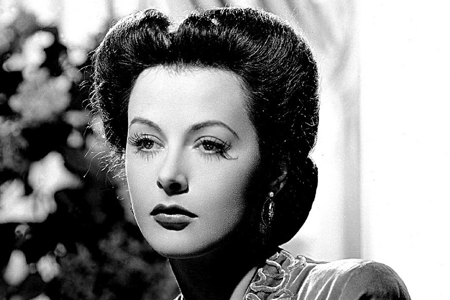 Hedy+Lamarr%2C+%22The+Most+Beautiful+Woman+in+the+World%2C%22+remembered+for+her+conception+of+frequency-hopping+spread+spectrum%2C+the+foundation+of+WiFi%2C+Bluetooth%2C+and+cellular+communications.