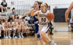 Junior Carly Davey charges down the court, controlling the ball.