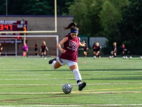 Soccer player Dominique Paglia is in action.