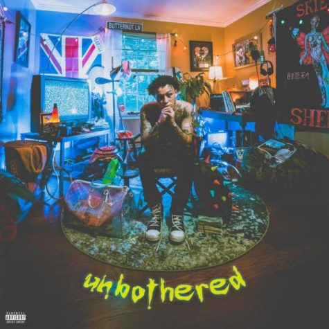 "Rapper Lil Skies poses for his album cover on ""Unbothered"" as he is surrounded with bags and items from his childhood."
