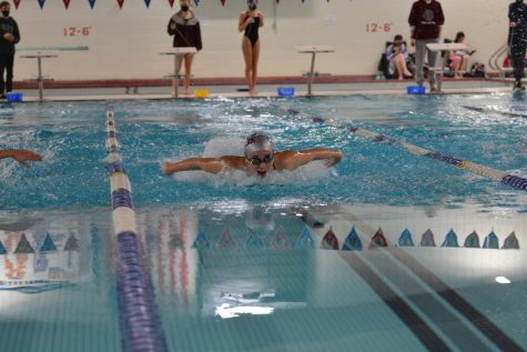 Senior Michaela Martin leads in the 100 yard butterfly.
