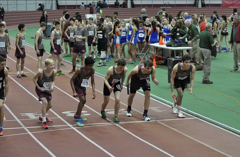Members of the boy's winter track team preparing for a race at BU